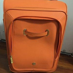 Orange stylish suitcase